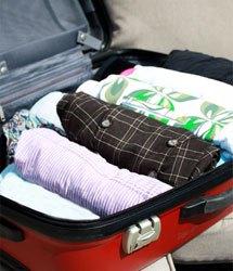 Bien boucler sa valise - Nos 11 conseils - Rouler affaires vêtement valise